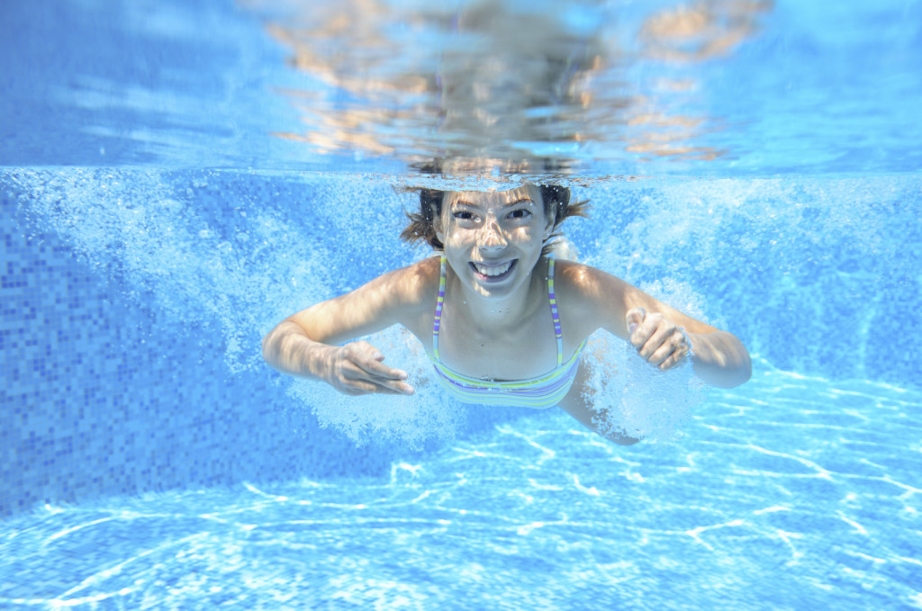Girl Swimming Underwater - iStock_000059442312_Medium