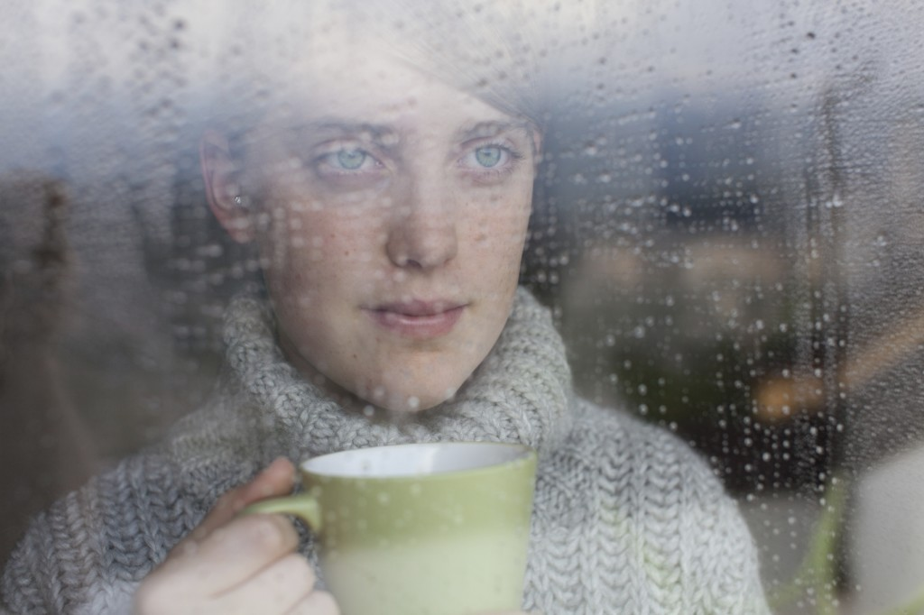 Woman and Rain - iStock_000021880389_Medium