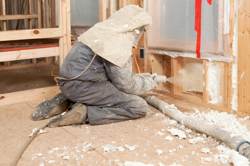 Worker Spraying Expandable Foam Insulation between Wall Studs iStock_000019521470_Small