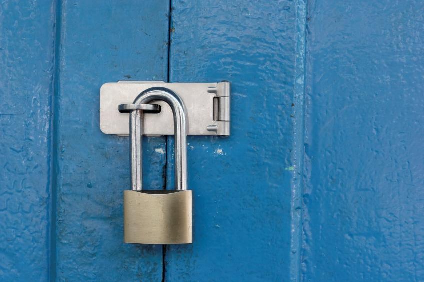 Padlocked on blue wooden door.
