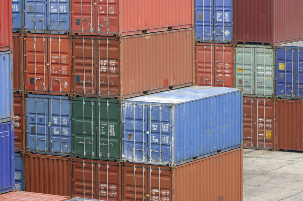 stacks of shipping containers at a port