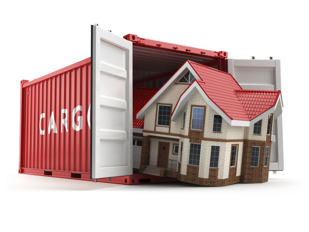 Moving house. Home and cargo shipping container isolated on whit