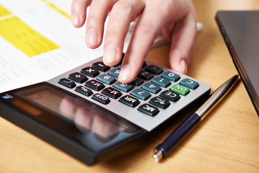 A woman's hand using a calculator