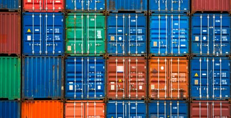 Four vertical rows of shipping containers